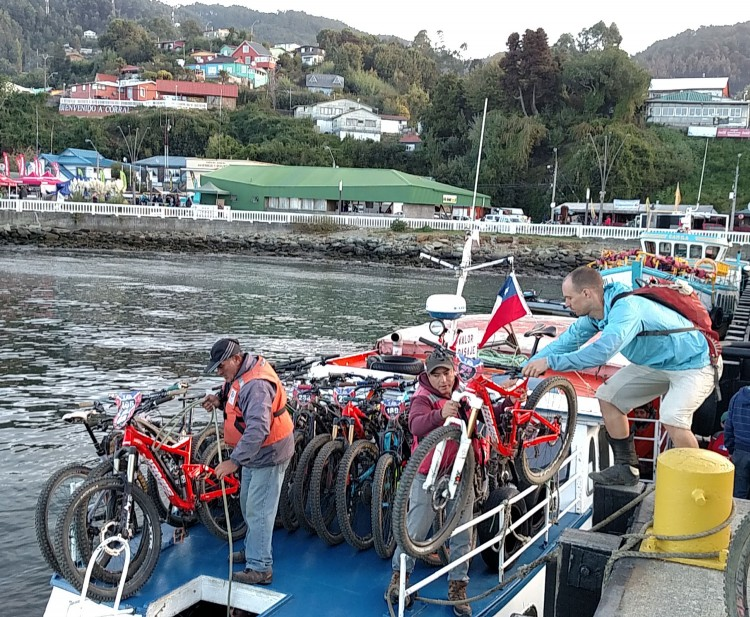 Loading bikes on to the water taxi after the end of a long day.
